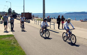 Bicyclists and pedestrians use a path in Seattle, Wash.