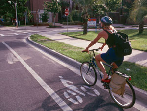 A bicyclist rides in a bike lane on a suburban U.S. street.