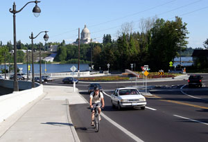 A bicyclist rides in a bike lane in Olympia, Wash.