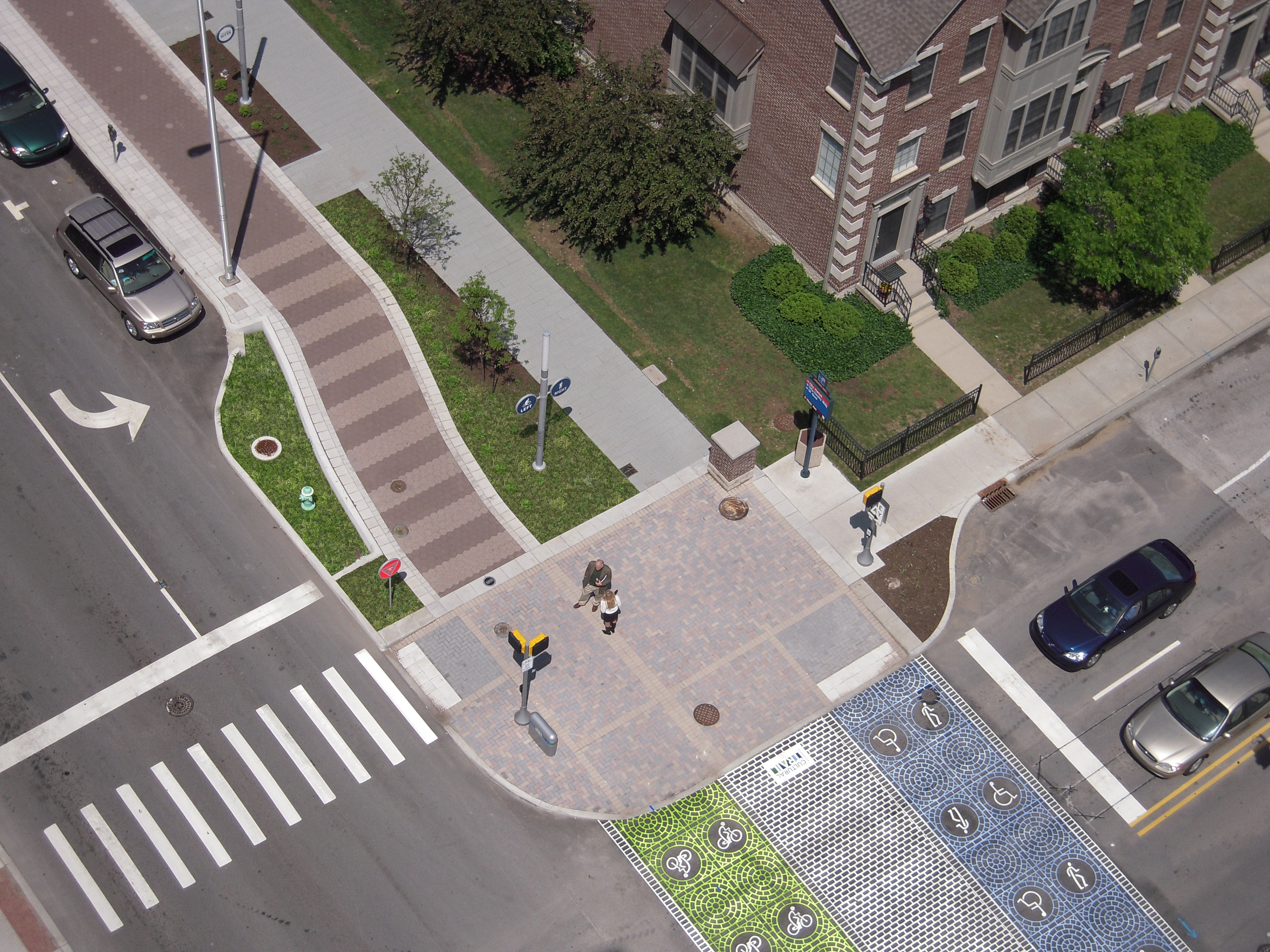 The design team bumped out the curbs to reduce crossing distances and used special pavement markings in the crosswalk.