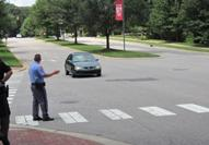 Law enforcement officers participate in hands-on exercises about pedestrian safety.