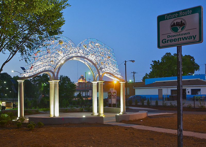 The Gateway of the Open Book by Brower Hatcher is public art installation on the Morehead Park section of the Downtown Greenway.