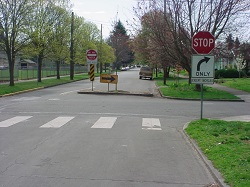 Pedestrian refuge islands were added at the school crosswalks on both Prescott and Fremont Streets near 18th Avenue.