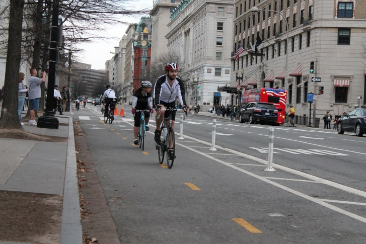 Bicyclists using the 15th Street cycle track, between E Street and Pennsylvania Ave.