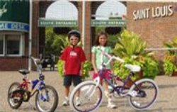 Two children pose with their bikes.