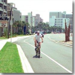 A bicyclist rides along a bike lane in SC.