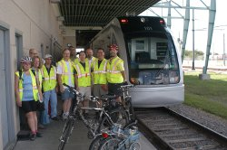 Bicyclists in front of a METRO train.